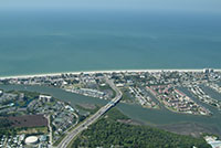 South Indian Rocks Beach florida.  Aerial photos overlooking the Gulf of Mexico.  Pictured are waterfront homes and condos available for sale.  Beautiful pictures of waterfront properties on the intracoastal and the beaches